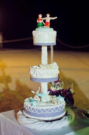 Wedding cake on the beach. Wedding in the tropics concept. Stock Photo
