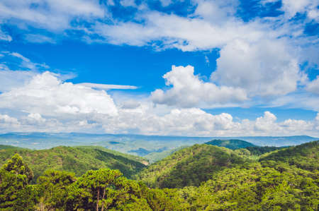 dalat: Fantastic landscape of Dalat Mountains, Viet Nam, fresh atmosphere, villa among forest, impression shape of hill and mountain from high view, wonderful vacation for ecotourism in spring.