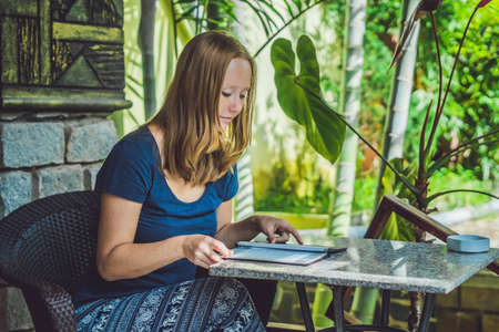 what to eat: Beautiful woman ordering from menu in restaurant and deciding what to eat.