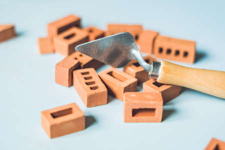 learning new skills: Real small clay bricks at the table. Early learning. Developing toys. Construction concept.