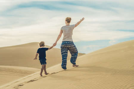 Mom and son in the desert. Traveling with children concept.