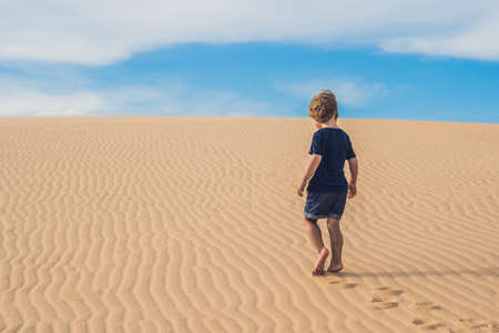 Boy in the desert. Traveling with children concept.