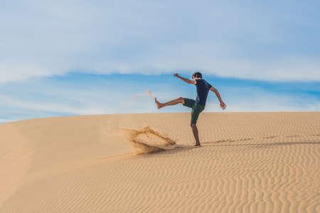 enraged: Man kicks the sand, annoyance, aggression Desert Vietnam