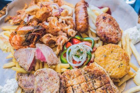 meaty: Big set Greek food Meat plate with potatoes and sauce.