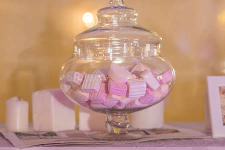 White and pink marshmallows in a jar. Stock Photo