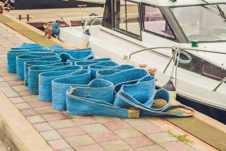 ship anchor: Sea ropes on the pier. Equipment for tying yachts concept.