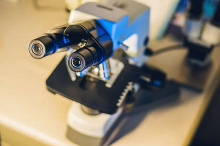 optical microscope in a scientific laboratory. Study of biological samples Stock Photo