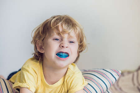 Three-year old boy shows myofunctional trainer to illuminate mouth breathing habit. Helps equalize the growing teeth and correct bite. Corrects the position of the tongue. Stok Fotoğraf