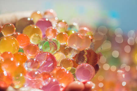 Colored balls of water beads, hydrogel in in hands. Sensory experiences. Stok Fotoğraf