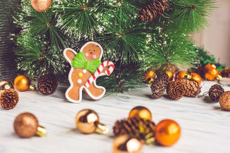 christmas decoration over wooden background and gingerbread man stock photo 85680436