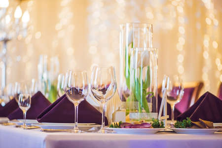 Empty glasses set in restaurant. Catering service concept. Stock Photo