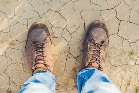 voyage: Feet trekking boots hiking Traveler alone outdoor wild nature Lifestyle Travel extreme survival concept summer adventure vacations steps sole view from top
