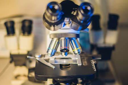 transmit: Optical microscope with four different objective lenses. Stock Photo
