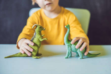 paleontologist: Boy showing a dinosaur as a paleontologist.
