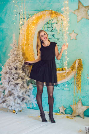 Holidays, celebration and people concept - young woman over christmas interior background. Image with grain. Banque d'images