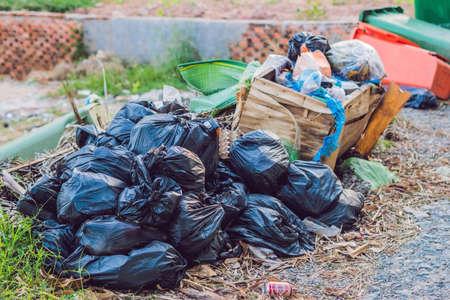 Big pile of garbage and waiste in black bags.