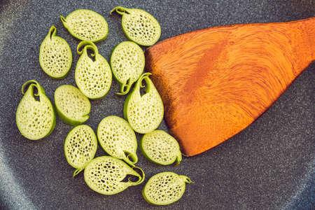 Unusual Asian edible plant. Porous inside. Vietnamese lulis eat. Stock Photo