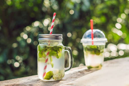 Zero waste concept Use a plastic glass or mason jar. Zero waste, green and conscious lifestyle concept. Reusable on the go drink container ideas. 版權商用圖片