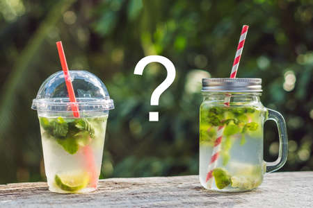 Zero waste concept Use a plastic glass or mason jar. Zero waste, green and conscious lifestyle concept. Reusable on the go drink container ideas. Stock Photo