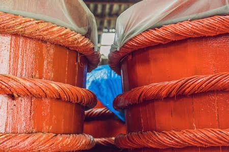 Wooden barrels in a fish sauce factory on Phu Quoc island. Reklamní fotografie