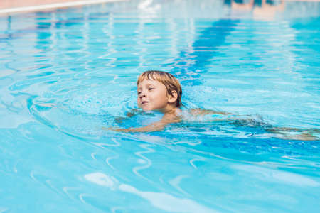 Activities on the pool, children swimming and playing in water, happiness and summertime.