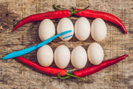 Eggs and peppers in the form of a mouth with teeth and a toothbrush. cleaning the teeth of the concept.