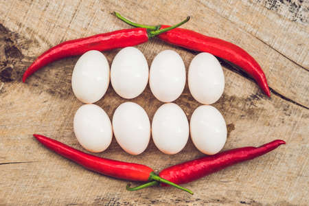 Healthy Smiling food face. Breakfast food concept, happy easter concept. White Smile Teeth from eggs and red pepper.