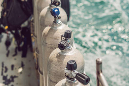 scuba compressed air tank on boat. Ready for diving. Stock Photo