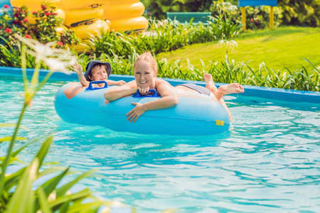 Mom and son have fun at the water park. Archivio Fotografico