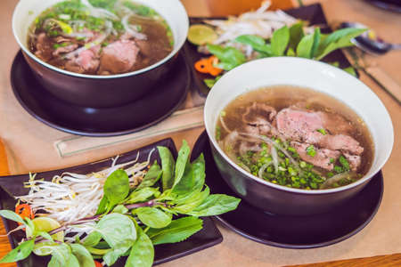 Pho Bo - Vietnamese fresh rice noodle soup with beef, herbs and chili. Vietnams national dish. 版權商用圖片