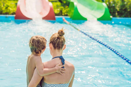 Mom and son have fun at the water park. Stock Photo