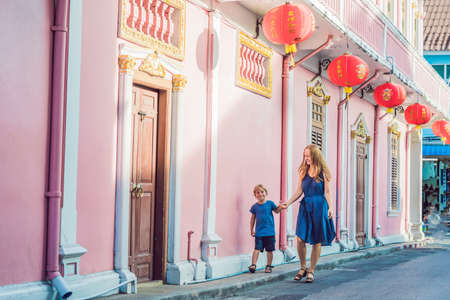Mom and son are tourists on the Street in the Portugese style Romani in Phuket Town. Also called Chinatown or the old town. Traveling with children concept