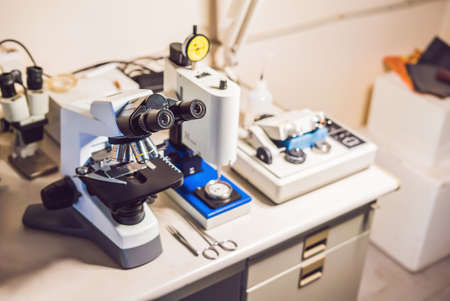 A sample preparation table in aelecron microscopy laboratory with an optical microscope, ultrasonic cutter system and precision micrometer grinder polishing machine