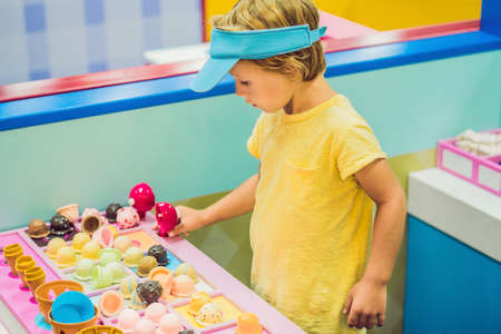 Children play as ice cream seller in the ice cream shop