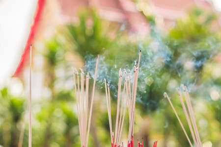 Smell the smoke of Incense, The smoke of joss stick in temple, smoke of incense in the spirit shrine.