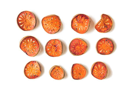 Bael fruit tea and slices of dried bael fruit, tea matum isolated on white.