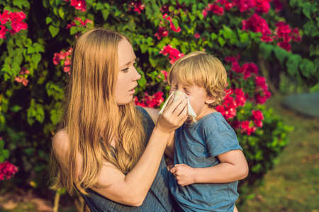 Mom looks at his son who is allergic to pollen. Stock Photo