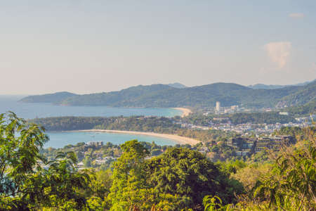 Tropical beach landscape panorama. Beautiful turquoise ocean waives with boats and sandy coastline from high view point. Kata and Karon beaches, Phuket, Thailand.