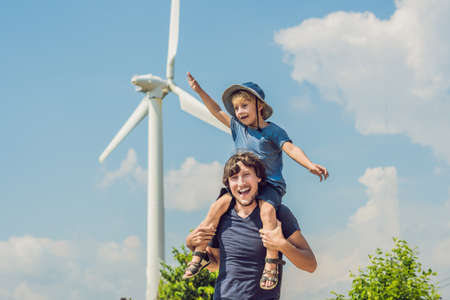 Father carrying son on shoulders and waving their arms like a windmill Foto de archivo