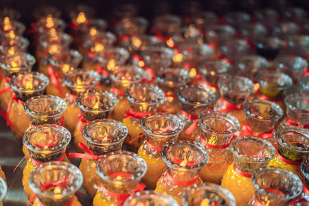 Candles in the Buddhist temple of Kek Lok Si in Malaysia. Stock Photo