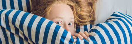 Beautiful young woman lying down in bed and sleeping. Do not get enough sleep concept. BANNER, long format