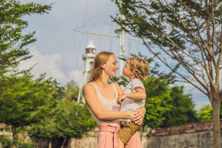 Mom and son on background of Fort Cornwallis in Georgetown, Penang, is a star fort built by the British East India Company in the late 18th century, it is the largest standing fort in Malaysia. Traveling with children concept.