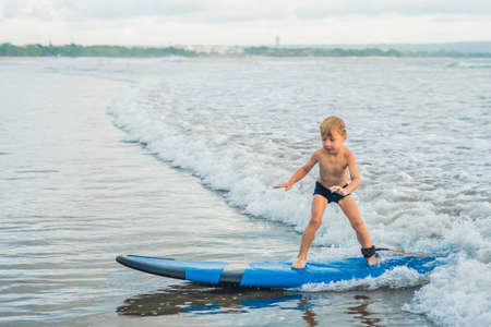 Water Board Sports >> Little Boy Surfing On Tropical Beach Child On Surf Board On Stock