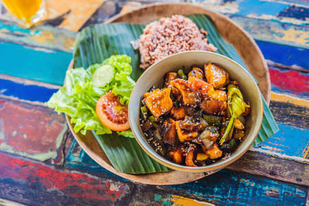 Popular Balinese meal of rice with variety of side dishes which are served together with the rice and more as optional extras. Фото со стока