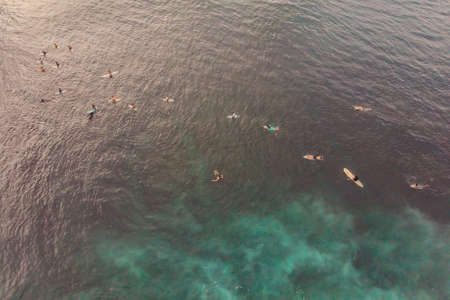 Surfers on the waves in the ocean, top view. 写真素材