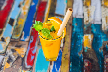 Immune boosting, anti inflammatory smoothie with orange and turmeric. Detox morning juice drink, clean eating. Stock Photo