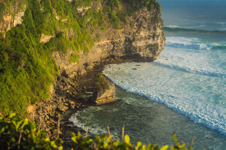 Pura Luhur Uluwatu temple, Bali, Indonesia. Amazing landscape - cliff with blue sky and sea. Stockfoto