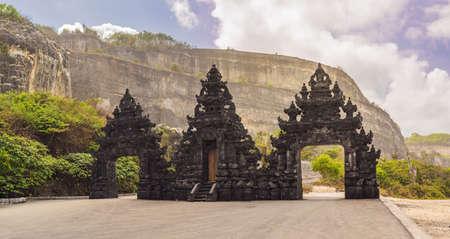 Traditional hindu gate to enter to Melasti beach in Bali, Indonesia.