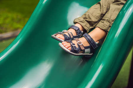 children's orthopedic shoes on the boy's feet.