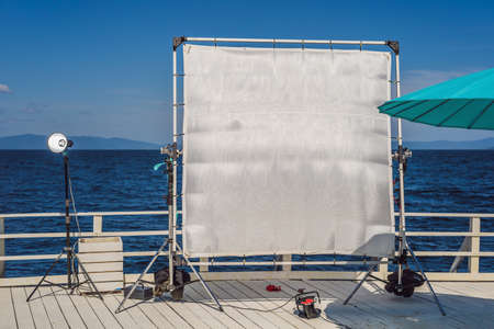 A big frame of a silk textile used for softening of the hard light on a cinema production set